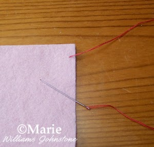 step 1 demonstrating hand sewing stitch