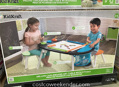 Give your child a place to sit and draw with the KidKraft Deluxe Chalkboard Art Table with Stools