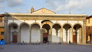 The facade of the Basilica della Santissima Annunziata in the San Marco district of Florence