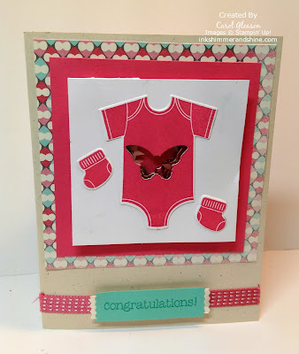 Pink Onesie with butterfly shape shaker filled with sequins.