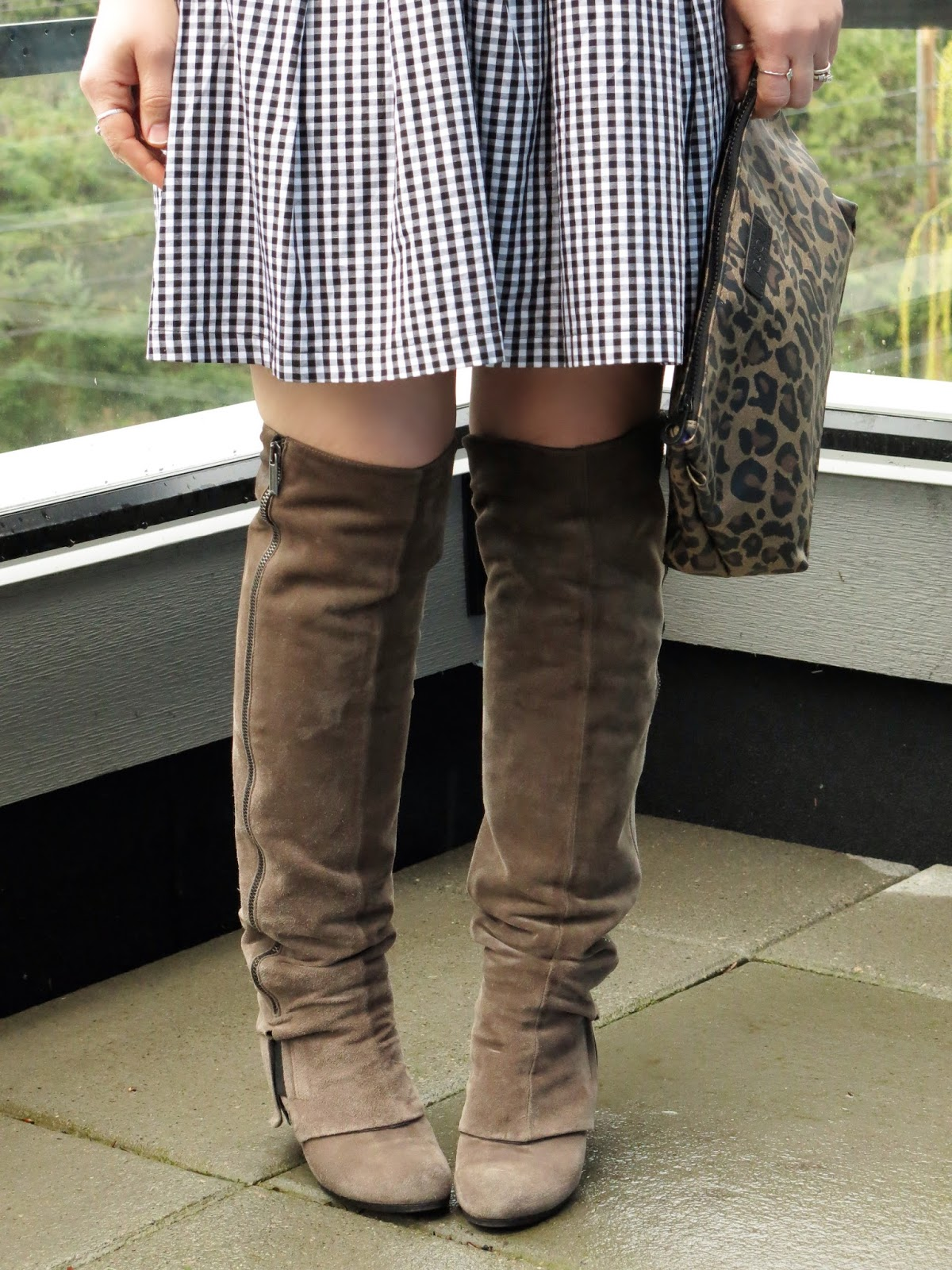 gingham skirt, over-the-knee boots, and leopard clutch