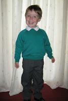 Small boy in school uniform
