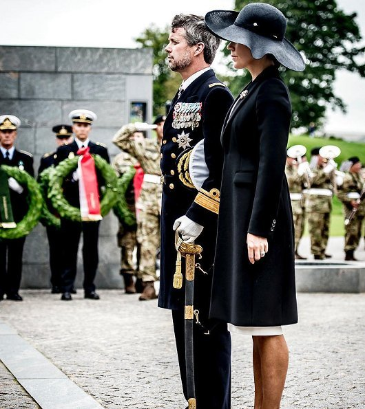 Prince Frederik and Crown Princess Mary at wreath-laying ceremony Prada Cappotto black coat. Gianvito Rossi Pumps, Hugo Boss clutch