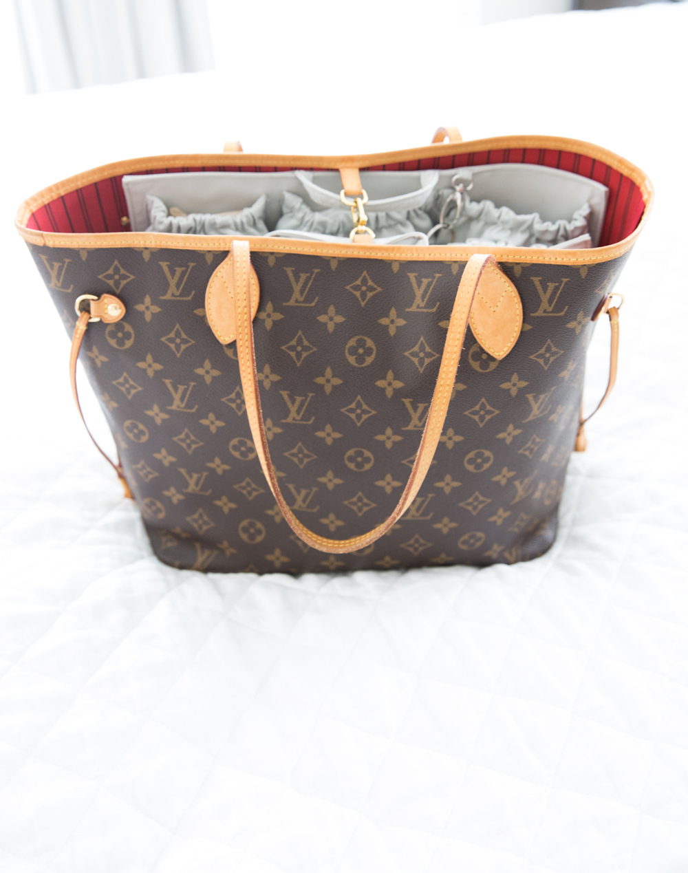 258190850eb7 Below are some pictures of the fit in the Neverfull MM. It s definitely  much tighter