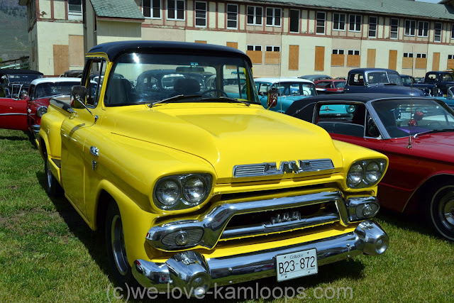 This bright yellow truck stands out in the crowd