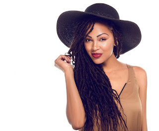 Meagan Good long black goddess locs with hat
