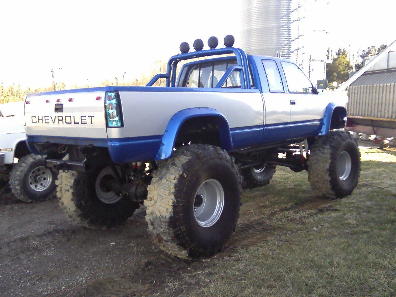 jacked up chevy trucks mudding - photo #25