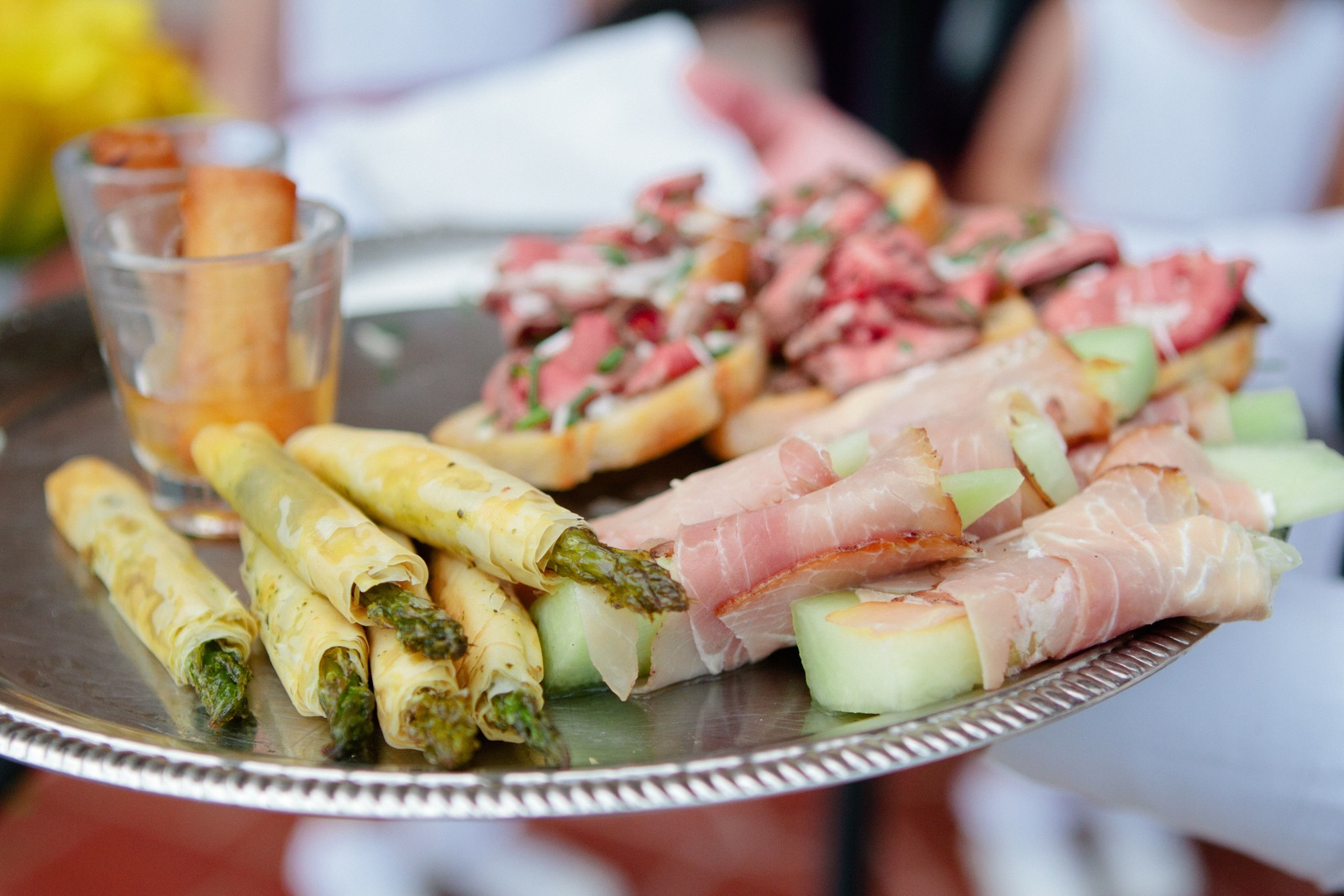 Wedding Brunch Reception - Vegetable Spring Roll Shooters with Duck Sauce, Beef Tenderloin Crostini, Filo-Wrapped Asparagus with Pesto, and Prosciutto-Wrapped Melon - Photo Courtesy of Brian Samuels Photography
