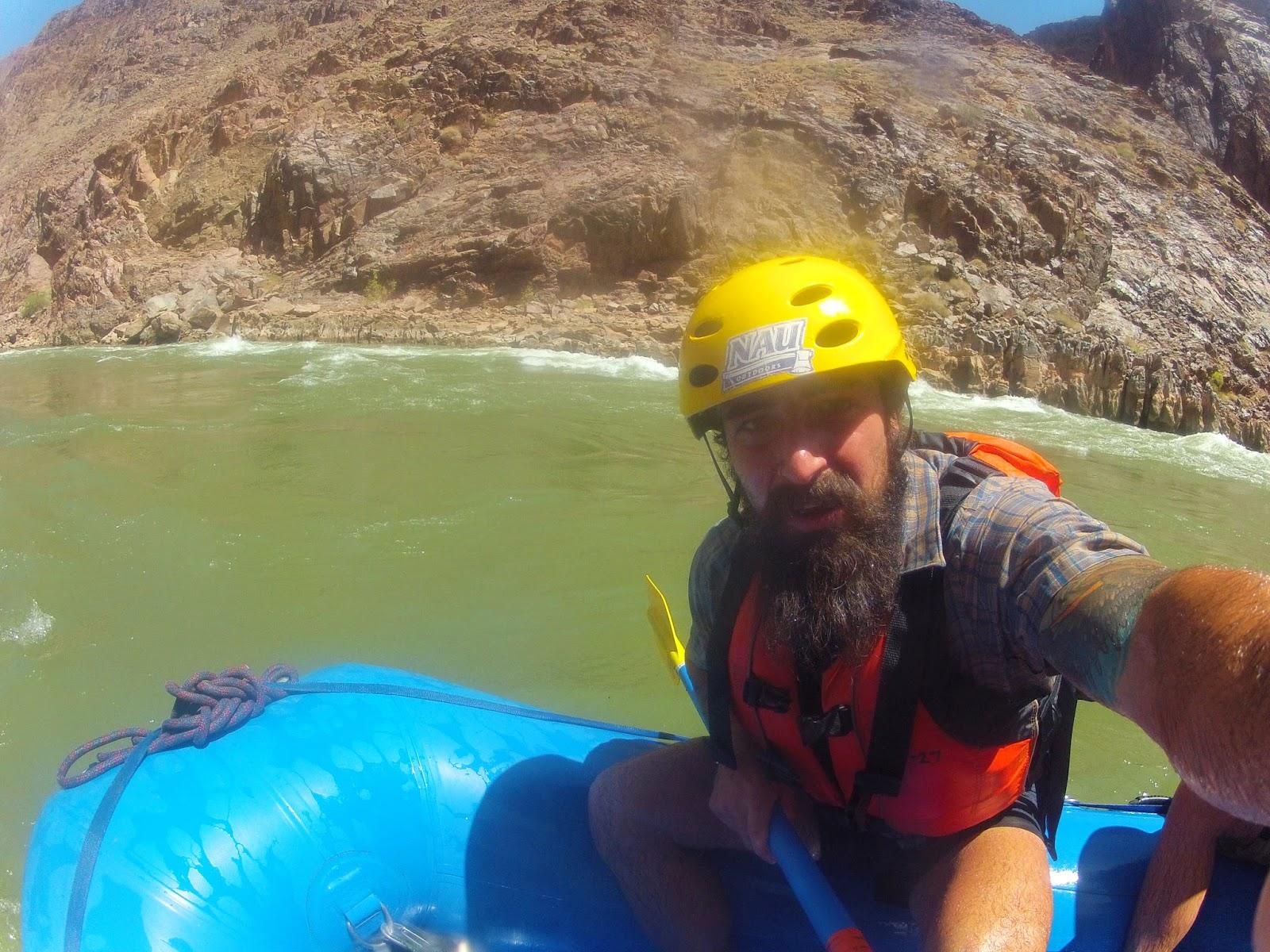 rafting selfie yellow helmet