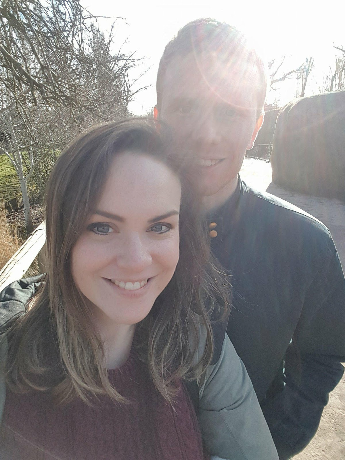 couple standing in sunshine