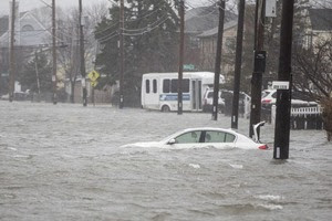 Eight dead, streets flooded, cities paralyzed by massive East Coast storm