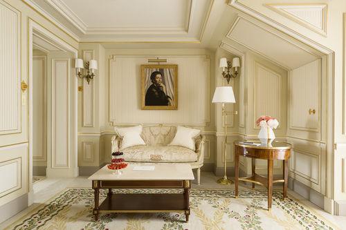 Elegant cream and neutral guest suite with oil painting Ritz Paris