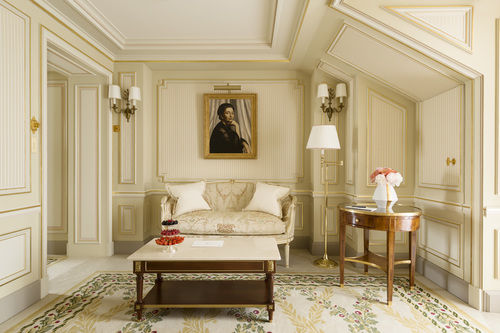 Elegant cream and neutral guest suite with oil painting Ritz Paris