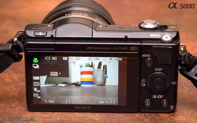 My all-black Sony Alpha 5000 with its intuitive control buttons