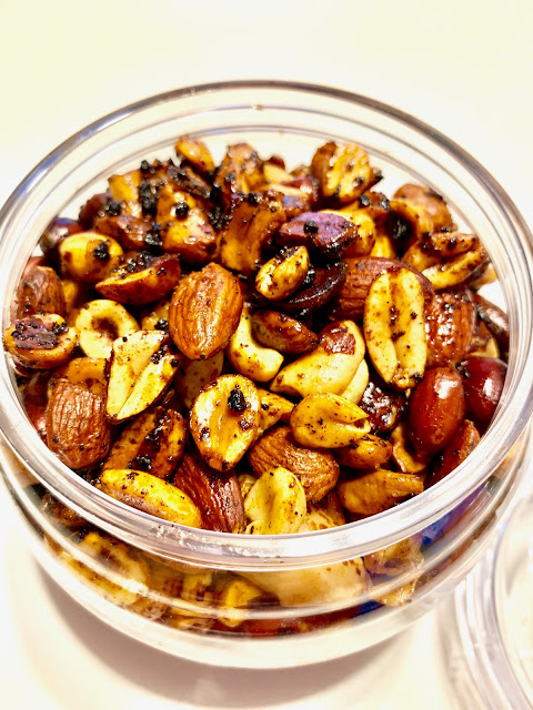 jar of roasted spiced nuts of all kinds