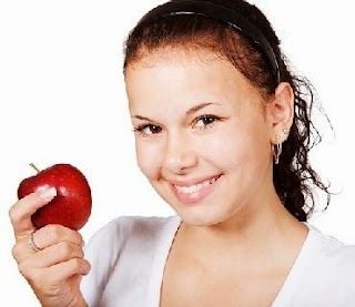 teen with apple