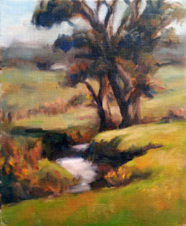 Oil painting of two manna gums beside a creek with distant hills.