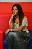Eesha in a cute deep neck top and Skirt at at Big FM 059.JPG