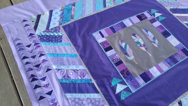 purple and aqua feather round robin quilt