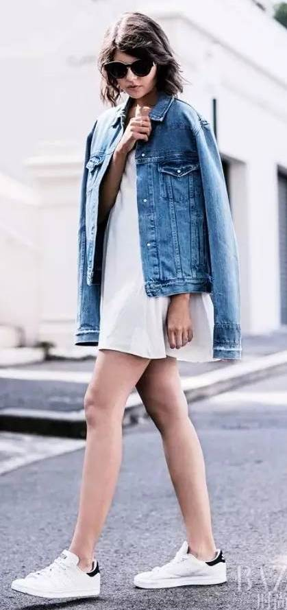 how to style a denim jacket : white skirt + sneakers