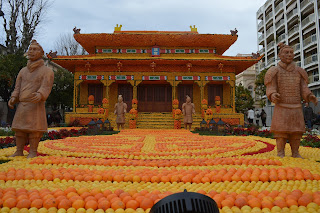 Pic of patterns of oranges and lemons with a Chinese theme and figures