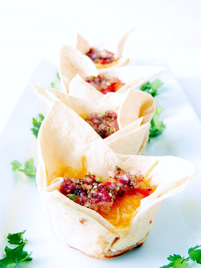 Ham and Cheese Breakfast Burrito Bites - A quick and easy way to make a breakfast the whole family will love. From www.bobbiskozykitchen.com #breakfast #burrito #ham #cheese #easy #recipe From www.bobbiskozykitchen,com