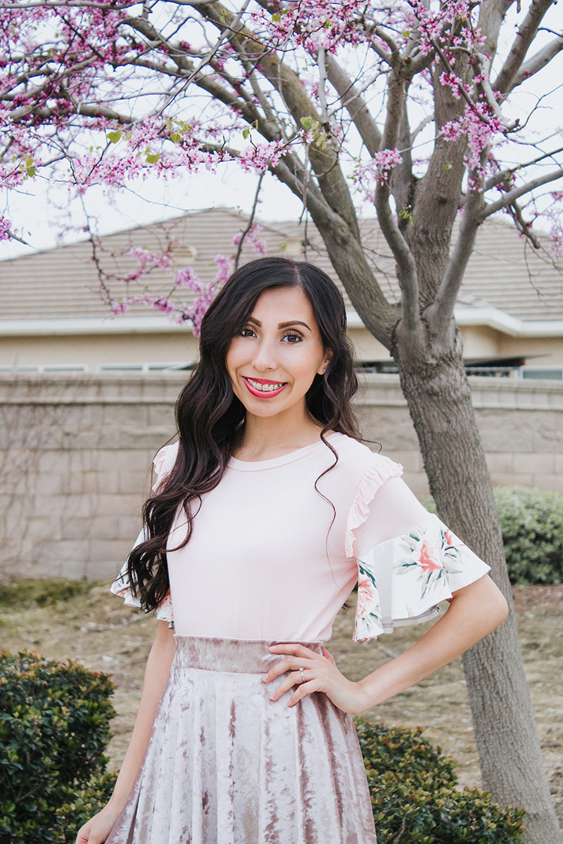 blush flounce top with floral tree background