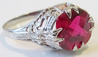 Ruby and white gold filigree ring by Ostby Barton (Art Deco or Edwardian)
