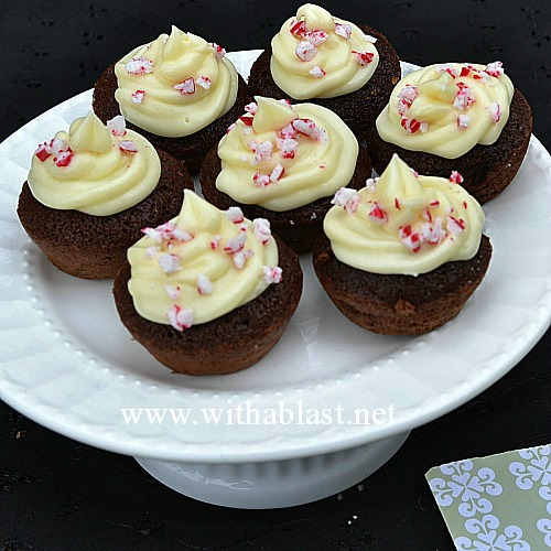 Moist mini Candy Cane Brownie Bites with a White Chocolate Cream Cheese Frosting and sprinkled with crushed Candy Cane