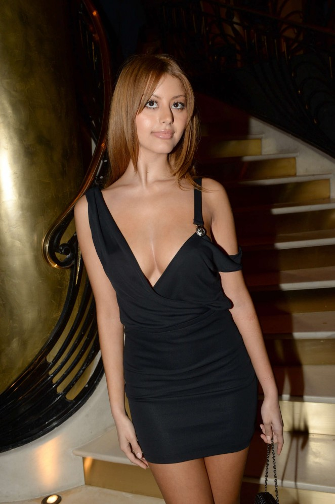 Zahia Dehar bares cleavage at restaurant opening in Paris