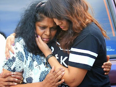 Raji Sukumaran is comforted by a family member after holding a press conference at the Grand Liana after seeing her son and Bali 9 ringleader Myuran Sukumaran for the last time before his execution.
