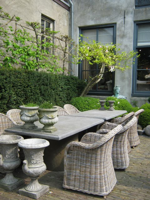 Grey rattan kubu chairs in a Modern Country Garden