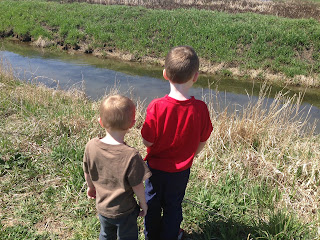 boys looking at fish and water at nature preserve