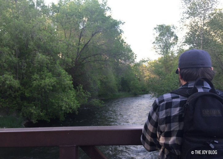 Man overlooking river surrounded by trees // www.thejoyblog.net
