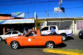 Classic orange truck in Puriscal