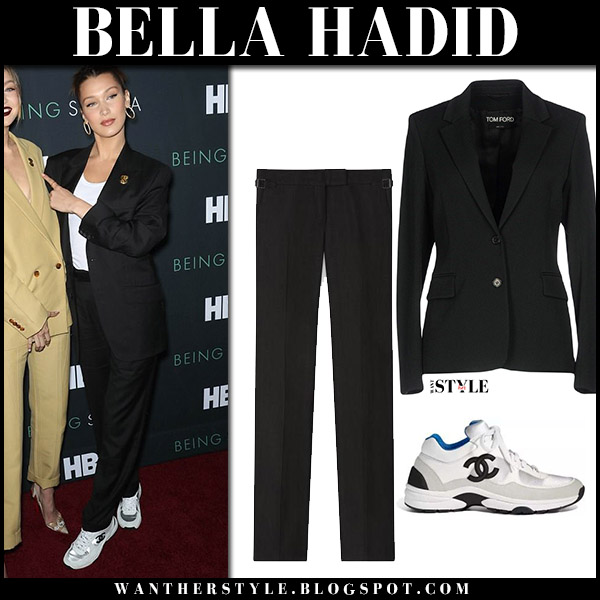 Bella Hadid in black jacket, white top and black pants tom ford model style april 25 red carpet