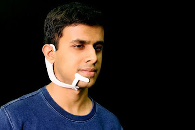 The device functions by detecting signals in the jaw and face that are triggered by internal thoughts, but are undetectable to human eyes, these signals are then fed to a machine-learning system that is trained to associate certain signals with certain words.  The device includes a pair of bone-conduction headphones, that transmit vibrations through the bones of the face to the inner ear conveying information to the user without interrupting their conversation.