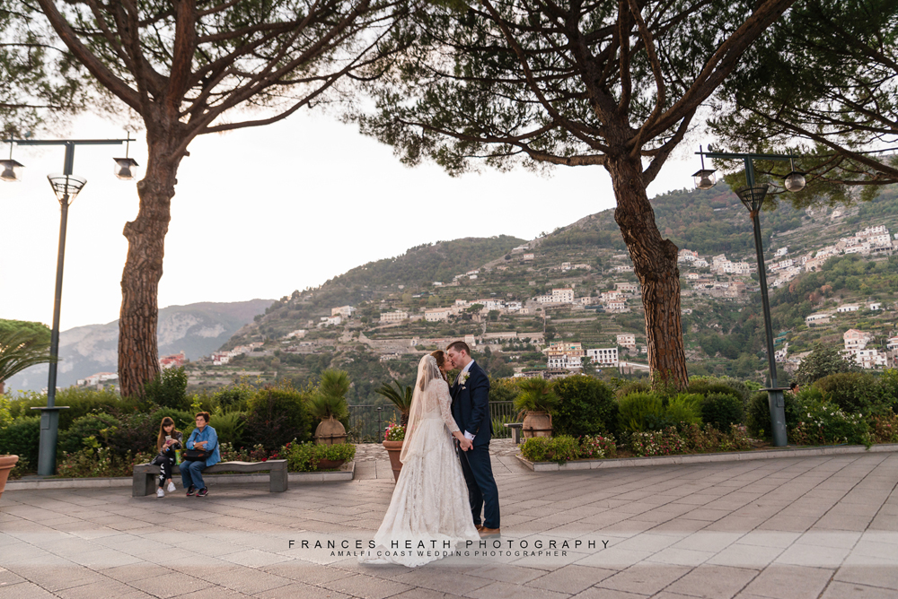 Wedding portrait of bride and groom kissing