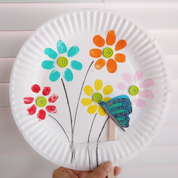 Make a cut in the paper plate such that the craft stick attached to the butterfly moves comfortably through it.  sc 1 st  The Joy of Sharing & The Joy of Sharing: Fingerprint Flowers And Flying Butterfly ...