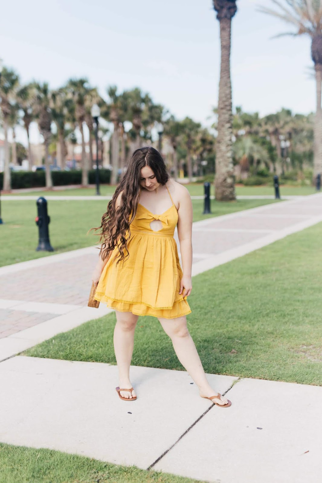 Girl wearing Endless Rose Canary Yellow Tiered Ruffle Short Mini Dress from Revolve