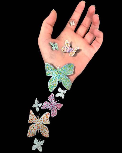 Body paint en un brazo- Mariposa