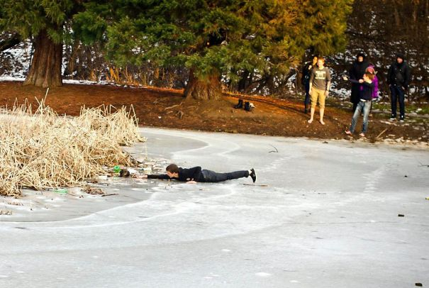 Teenage boy rescues a stray dog from drowning in a frozen lake (sofia, bulgaria).