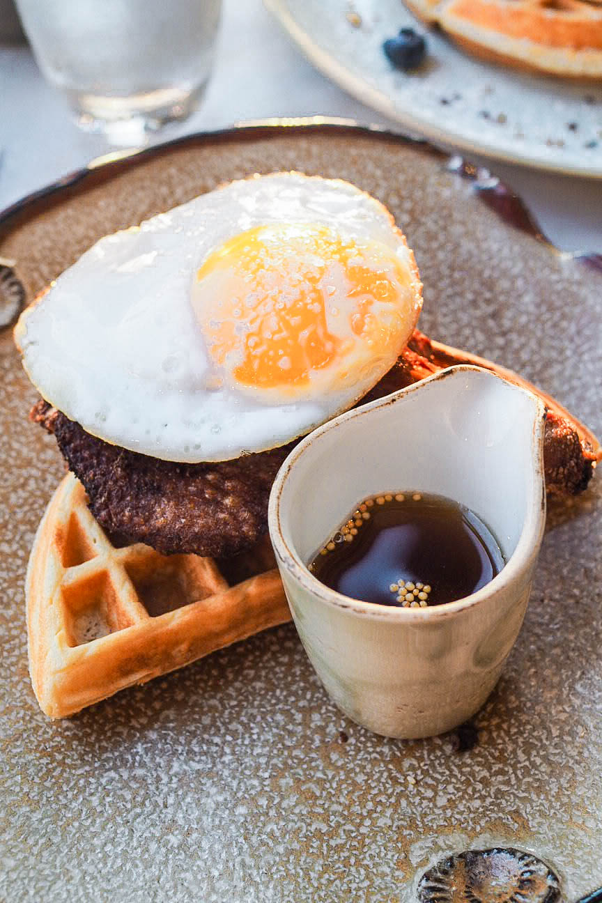 Waffle with confit duck leg, fried duck egg and mustard maple syrup