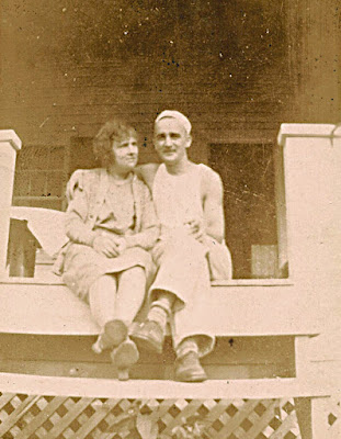 Mystery Photo! A woman and a man sitting on the porch of a house in the country. Unidentified, probably Dixon family.