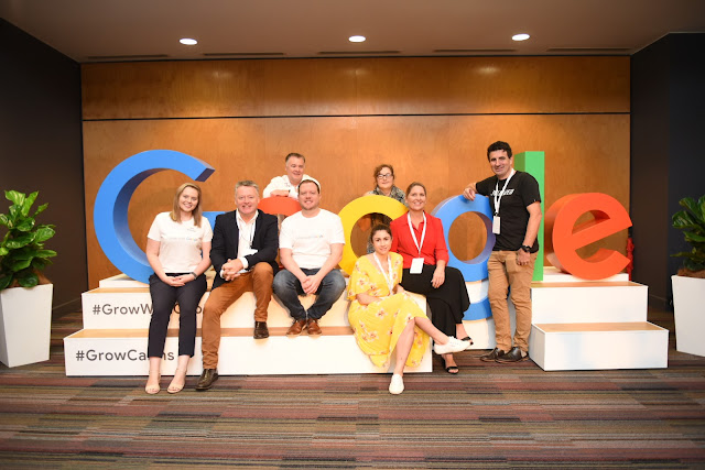Photo of team at the Grow with Google event. Front row: Hannah Frank (Google Australia), Michael Healy MP, Richard Flanagan (Google Australia), Anna Fredericks (James Cook University), Debbie-Anne Bender (CEO, Cairns Chamber of Commerce), Nick Loukas (President, Cairns Chamber of Commerce)