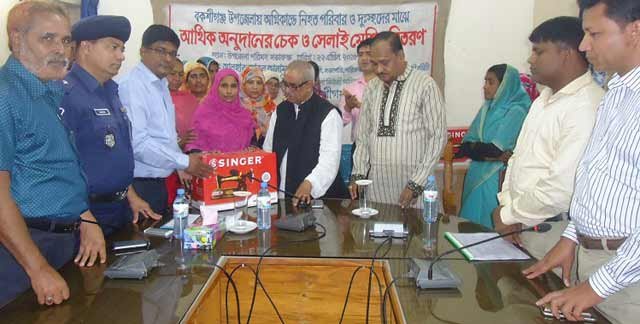 distribution of financial donations among the poor in Bakshiganj