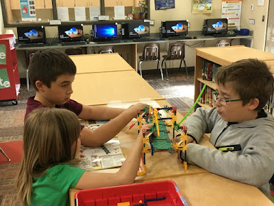 Two boys and girl play with LEGO makerspace kit