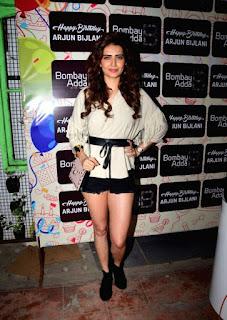 Kriti Kharbanda Long Legs Show Pos In Mini White Dress (1)