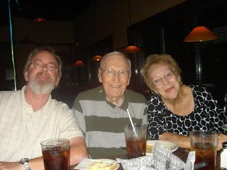 Betty and Johnny Morton with Mark Leonard
