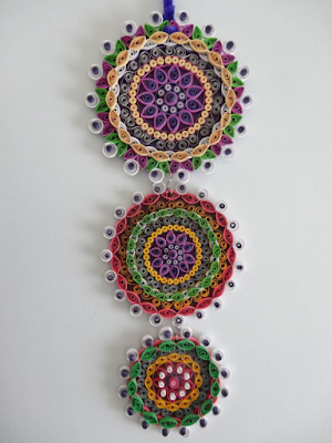 Long tail wall hanging quilling paper designs - quillingpaperdesigns